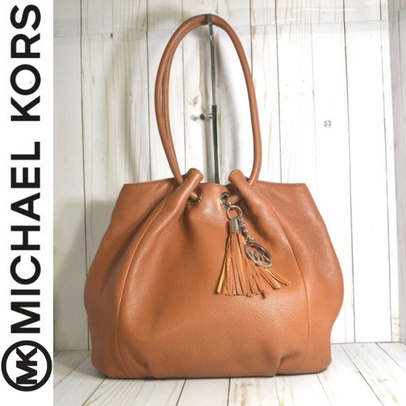 2d21eda1092d Michael Kors East West Brown Leather Ring Tote. M_5b5e43cb534ef9ce443523ab